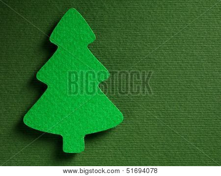 Christmas tree made of paper on paper texture, papercraft theme