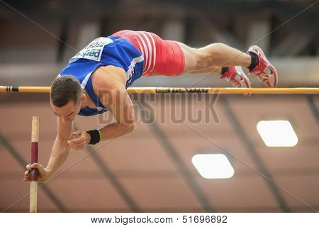 LINZ, AUSTRIA - JANUARY 31 Lucas Bechyne (#602 Czech Republic) places 5th in the men's pole vault event on January 31, 2013 in Linz, Austria.