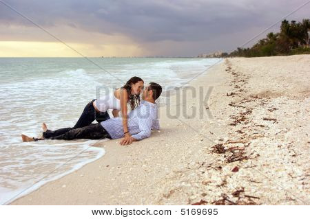 Fantasy Woman About To Kiss Man  On Beach At Sunset