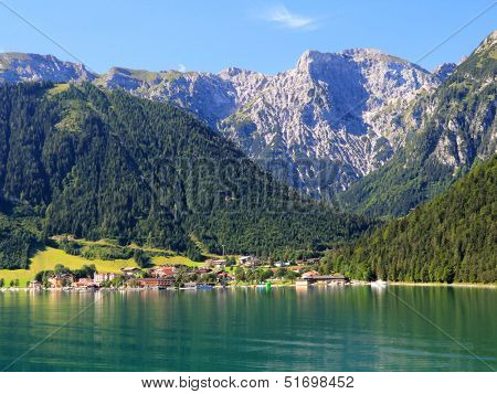 AUSTRIA - AUGUST 17 : The village along the Achensee Lake on August 17, 2012 in Tirol, Austria. The Achensee is the largest lake within the federal state, and has a maximal depth of 133 metres.