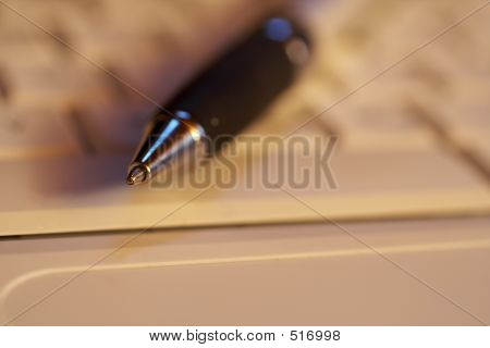 Macro Of A Pen With The Focus On The Tip On A Keyboard