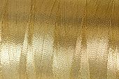 image of rayon  - The golden thread close up image as background - JPG