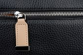 pic of zipper  - Close up of leather bag zipper - JPG