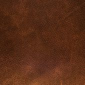 stock photo of raw materials  - Closeup detail of brown leather texture background - JPG