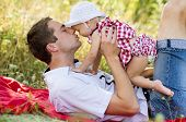 image of father time  - Happy young father spending time outdoor on a summer day with his beautiful daughter - JPG