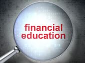 Education concept: Financial Education with optical glass on dig