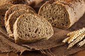 foto of fresh slice bread  - Fresh Homemade Whole Wheat Bread on a Background - JPG