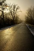 stock photo of long distance  - Long road through the winter countryside - JPG