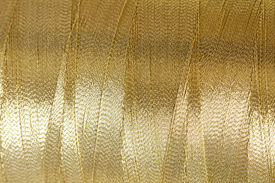 foto of rayon  - The golden thread close up image as background - JPG