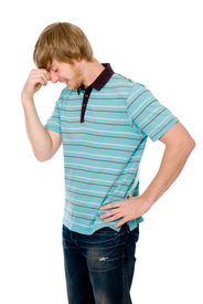 stock photo of thinkers pose  - Pensive young man in a pose of a thinker - JPG