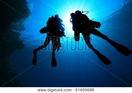 Two Tech Divers using rebreathers silhouette