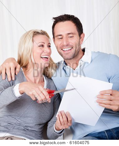 Laughing Woman About To Cut Up A Document
