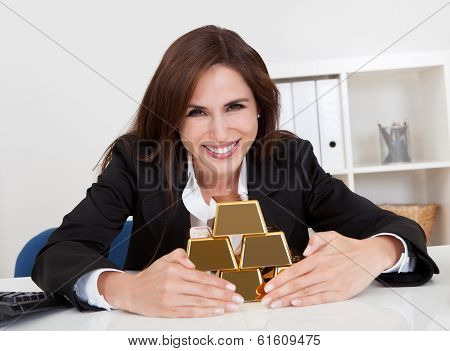 Businesswoman Holding Gold Bar