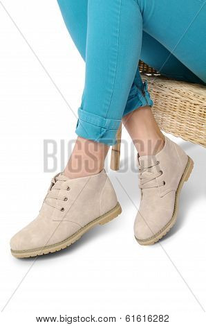 Woman legs with beige shoes