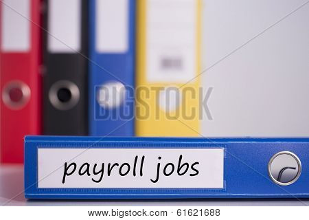 The word payroll jobs on blue business binder