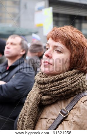 MOSCOW - MARCH 15: Woman listens to a speech on meeting in the time of protest manifestation against war in Ukraine , Circular Boulevards in Moscow, Russia on March, 15, 2014.
