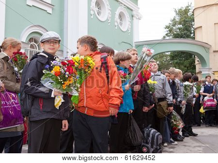SAINT PETRSBURG - SEPTEMBER 1: Children with flowers near the School on the first day of school on S