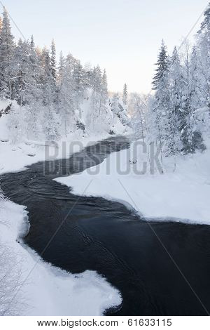 River In Snowy Forest At Winter