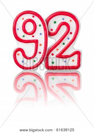 Red number 92 with reflection on a white background
