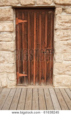 Wood door inset in brick wall