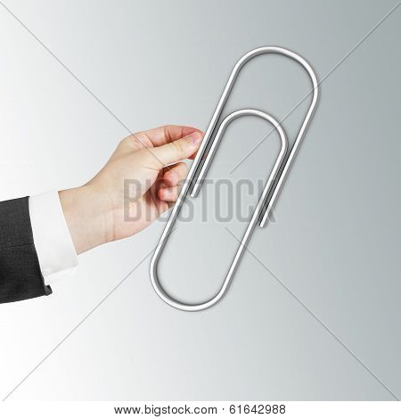 Hand Holding Paper Clip