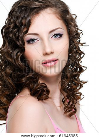 Close-up portrait of beautiful brunette woman with curly brown hair