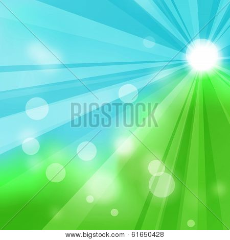 Natural green abstract background with the rays of the sun