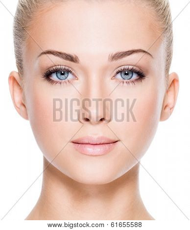 Face of beautiful young woman with beautiful blue eyes  - Closeup image on white background