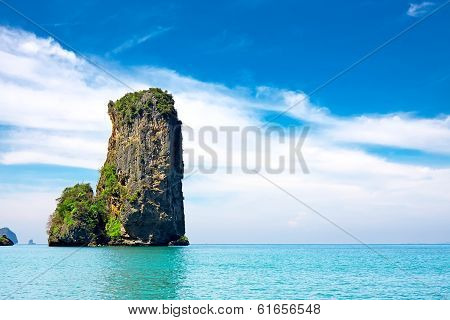 Tropical Beach With Sea And Limestone Rock