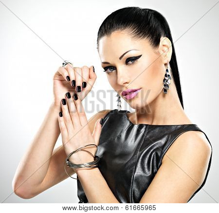 Beautiful fashion sexy woman with black nails at pretty face.