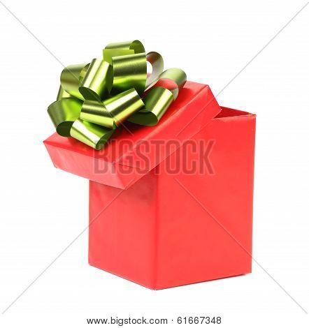 Open red gift box with green-golden bow.