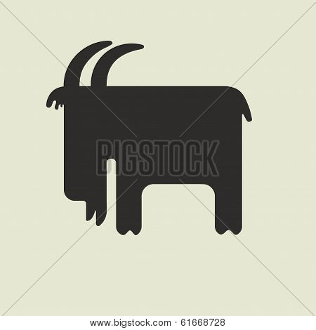 Silhouette of goat with horns standing sideways
