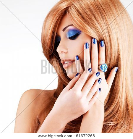 portrait of a beautiful woman with blue nails, blue makeup and red hairs  on white  background
