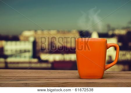 Steaming Coffee On The Window Background.