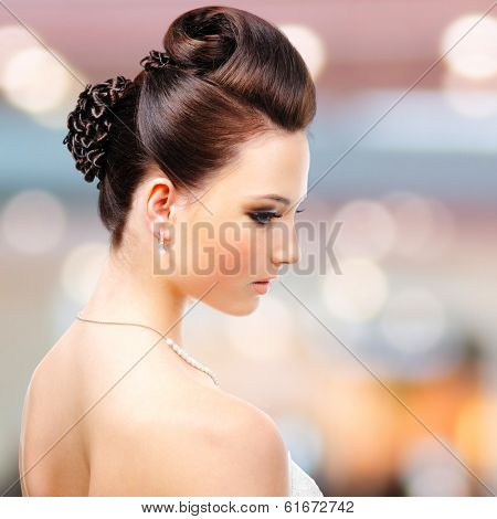 Beautiful woman with modern wedding hairstyle at studio