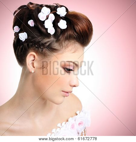 Profile portrait of  bride with beauty make-up and hairstyle