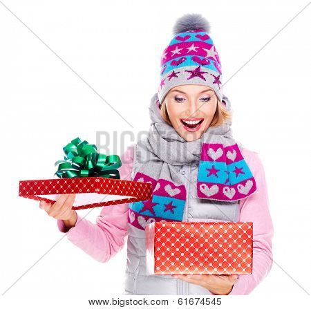 Photo of happy surprised woman with a christmas gift in a winter outerwear - isolated on white