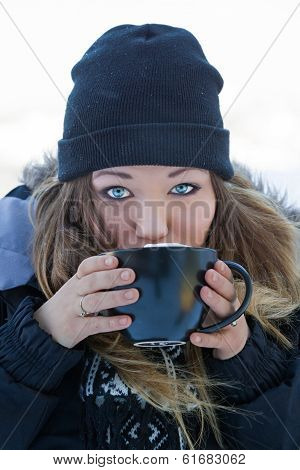 Beautiful Young Woman With Hot Chocolate
