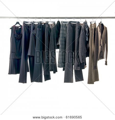 Set of female dress and trousers isolated on hanging