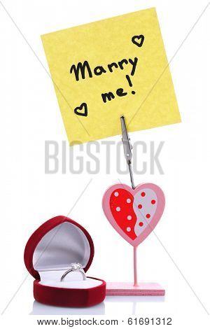 Composition with message holder, flowers and box with ring isolated on white