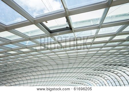interior of office building with metal and glass roof