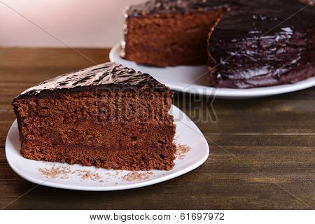 Delicious chocolate cake on table close-up