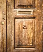 pic of postbox  - detail of old wood door with postbox for background - JPG