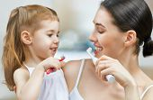 stock photo of toothpaste  - mother and daughter brush my teeth - JPG