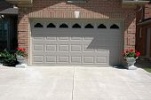 stock photo of driveway  - Garage door double with windows and cement driveway - JPG