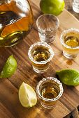 stock photo of shot glasses  - Tequila in Shot Glasses with Lime and Salt - JPG