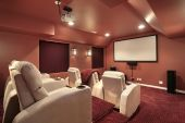 image of home theater  - Luxurious theater in upscale home with red walls - JPG