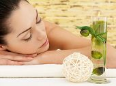 Relaxing white woman at beauty spa salon. Recreation therapy. Resting female with closed eyes