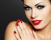 stock photo of fingernail  - Photo of  woman with fashion red nails and sensual lips  - JPG