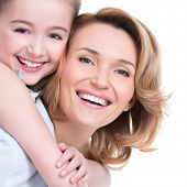 foto of daughter  - CLoseup portrait of happy  white mother and young daughter  - JPG